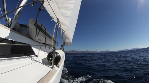 Sailing yacht on the race in blue sea Footage