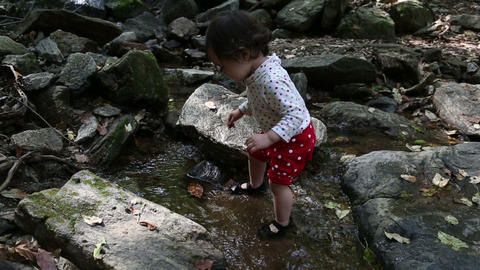 Baby Toddler 1 At The Creek stock footage