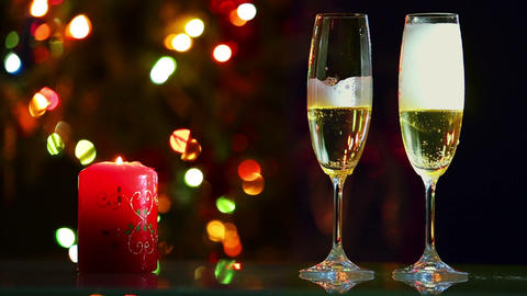 champagne is pouring into glasses and candle - rom Footage