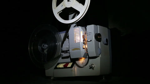 old projector showing film - dolly shot Footage