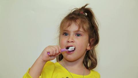 pretty little girl brushing her teeth Footage