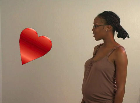 Beautiful Pregnant Woman Adjusts a Crooked Heart Stock Video Footage
