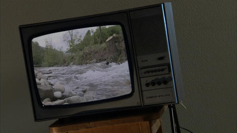 Destruction of television set by a bottle Stock Video Footage