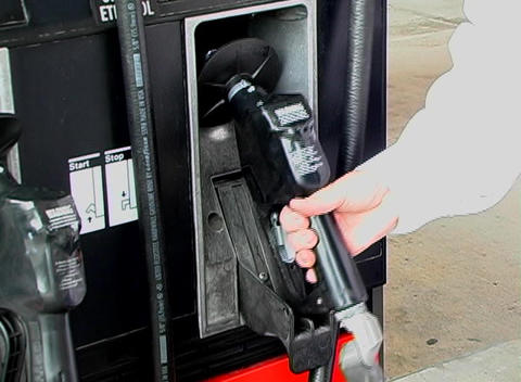 Removing the Handle at a Gasoline Pump Footage
