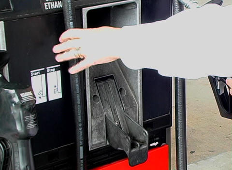 Removing the Handle at a Gasoline Pump Stock Video Footage