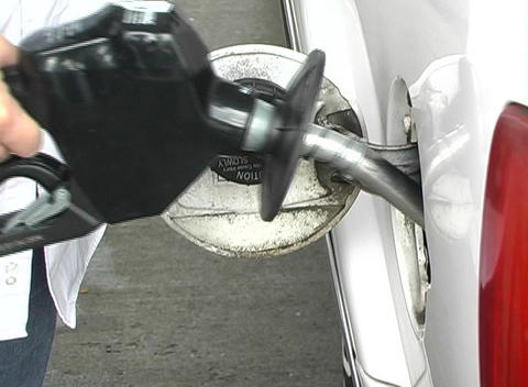 Inserting the Handle of a Gas Pump into a Vehicle Live Action