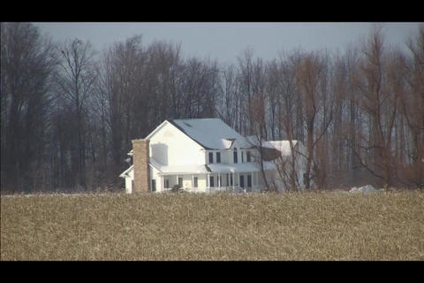 house in cornfield winter Stock Video Footage