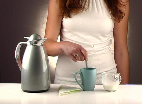 Woman Pouring Coffee, Studio Setup (1b) Stock Video Footage