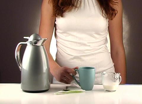 Woman Pouring Coffee, Studio Setup (1b) Stock Video Footage