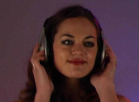 Beautiful Brunette Listens to Music with Headphones (3) Stock Video Footage