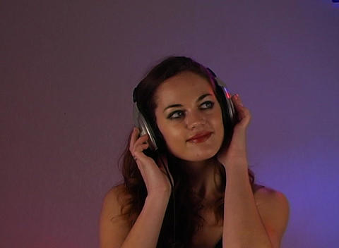 Beautiful Brunette Listens to Music with Headphones (3) Footage