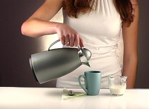 Woman Pouring Coffee, Studio Setup (1a) Footage