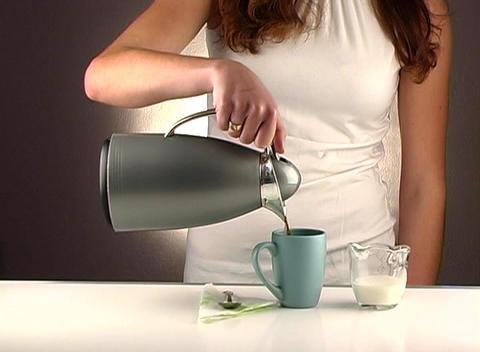 Woman Pouring Coffee, Studio Setup (1a) Stock Video Footage