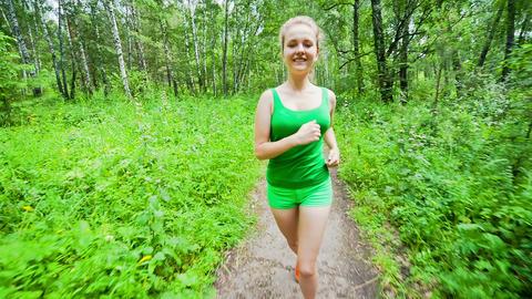 Teenager Girl Jogging in Park Footage