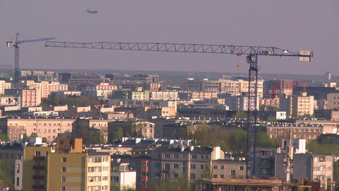Cranes With Plane In The Background stock footage