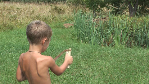 Child With A Slingshot stock footage