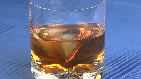 Ice Addition In Whisky stock footage
