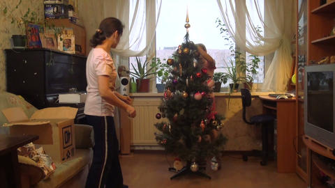 Mother with daughter decorate the Christmas tree Footage