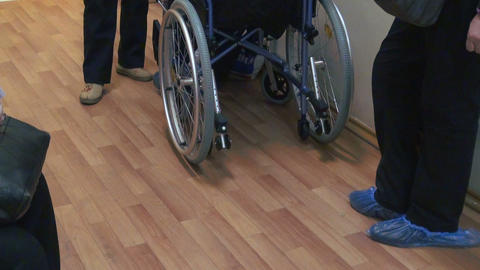 The Patient In A Wheelchair In The Clinic stock footage