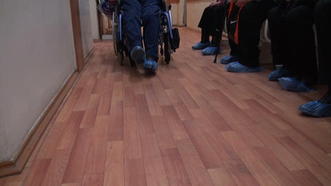 The patient in a wheelchair in the clinic Footage