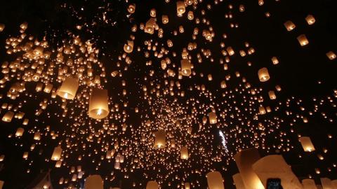 Launching flying lanterns for Loy Krathong Footage