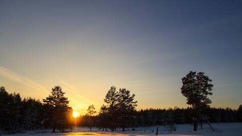 Winter landscape at sunset. Time Lapse. 4K Footage