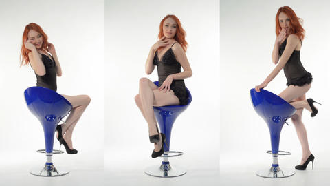Red-haired Girl Posing In Studio On A Blue Chair stock footage