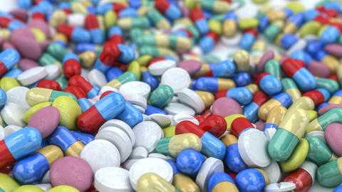 Pills And Capsules Placed On A Table stock footage