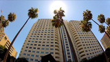 Low Angle Driving By High Rise Condo Buildings stock footage
