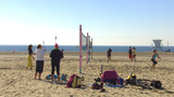 Young Adults In Volleyball Games At Beach stock footage