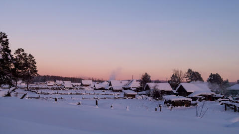 Winter village at sunse. Time Lapse Footage