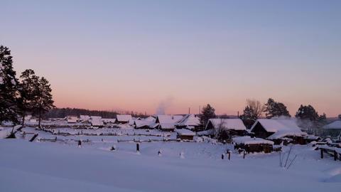 Winter village at sunse. Time Lapse Footage
