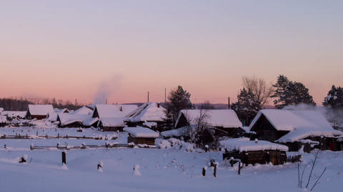 Village houses in winter at sunset. Time Lapse. 12 Footage