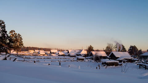 Winter village at sunset. Time Lapse. 4K Footage