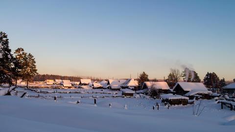 Winter village at sunset. Time Lapse. 4K Footage