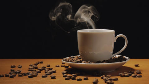 Cup of coffee on black background Footage