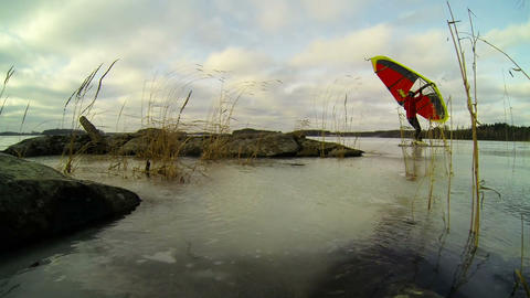 Windy Winter Lake With Kitewing Skier stock footage