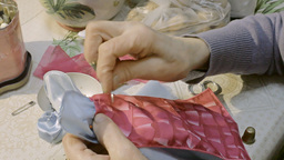 Grandma Sewing Doll Clothes stock footage