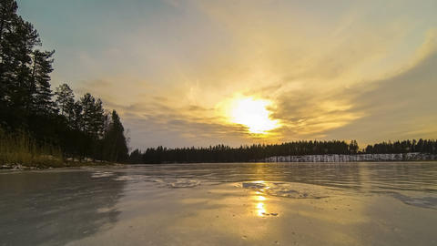 Sunset over icy lake time-lapse Footage