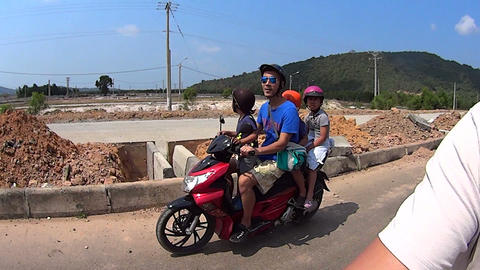 Motorbike, transportation of children. Vietnam Footage