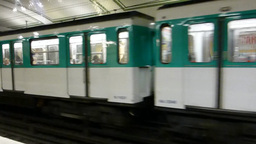 A moving train at Paris Métro station with sound. Footage