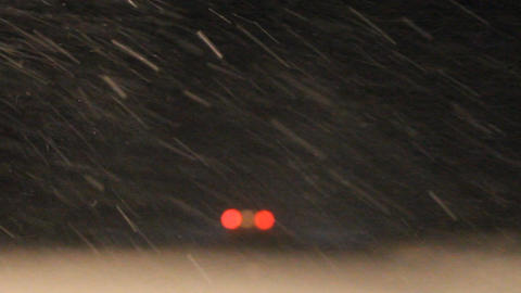 Night Snowstorm. The Car Moves On Snow With Poor V stock footage