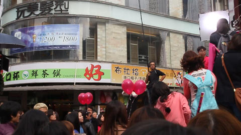 crowd in ximending watching local celebrity Animation