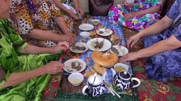 Ladies eat traditional Central Asian food Footage