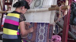 Young women makes carpets in factory Footage
