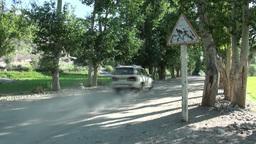 Jeep drives through Pamir village Footage
