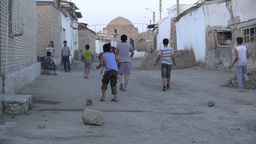 Kids Play Football In Streets Of Bukhara Uzbekista stock footage