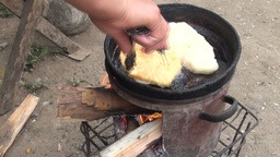 Frying food in unhealthy oil Central Asia Footage