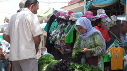 Buying lettuce at Central Asian bazaar Footage