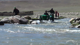 Riding a motorbike through river in Tajikistan Footage